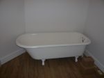 The long tub in the main bath upstairs